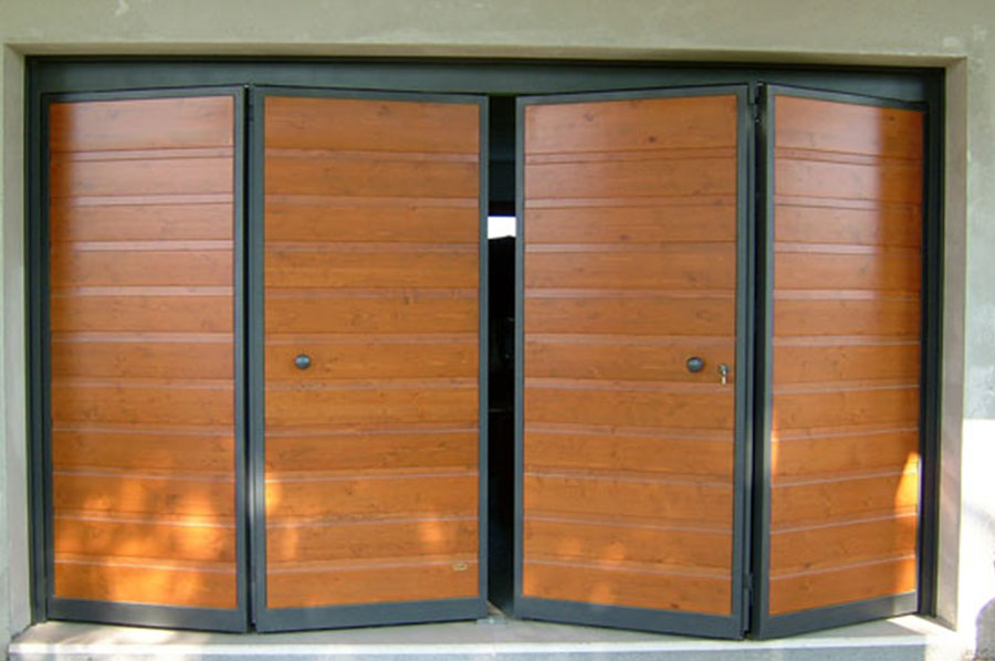 Portoni a libro per garage e capannoni a vicenza - Portoni garage con finestre ...